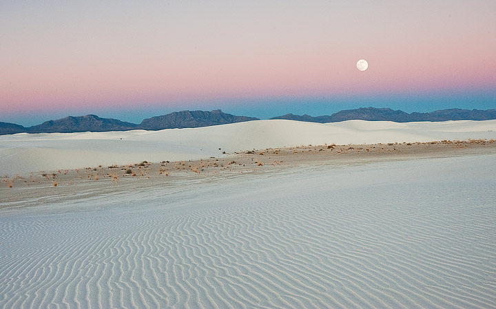 A full moon sets into the earth shadow on a cold January morning at White Sands NM, New Mexico