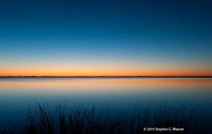 Dawn light over the lake at Cheyenne Bottoms Wildlife Area, Kansas