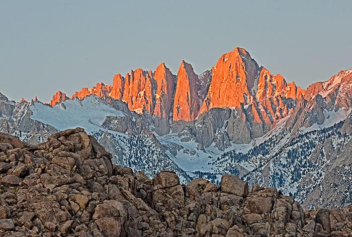 Sunrise lights up the East Face of Mt. Whiney, the highest peak in the Sierra Nevada Range, California